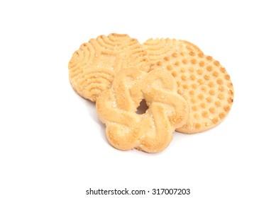 four tasty, fresh cookies on white background