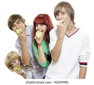 Four teenagers eat green apples