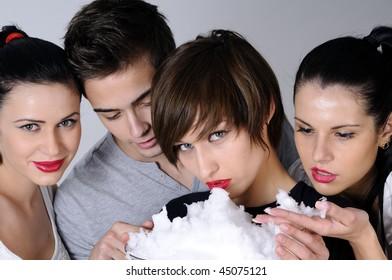 four teenagers feeling snow