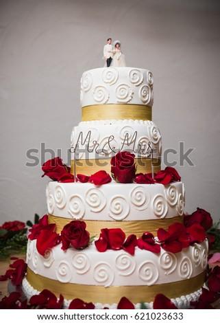 Four Tier White Gold Wedding Cake Stock Photo Edit Now 621023633