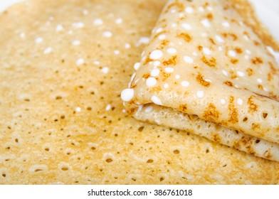 Four times folded pancake with sour cream closeup