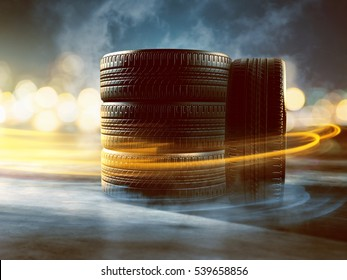 Four tires laying on the street