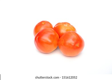 Four tomatoes on two rows isolated on white background