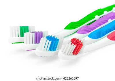 Four toothbrushes closeup isolated on white background