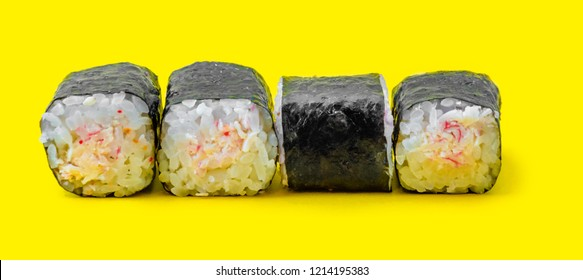 Four traditional sushi on a yellow background