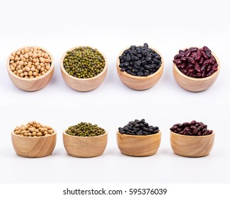 Four types of dry beans in the wooden bowlc