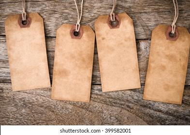 Four vertical Vintage Paper Label on Wood Background