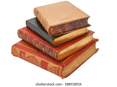 Four very old antiquarian books stacked on side in leather covers.