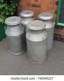 Four Vintage Metal Milk Churns Ready for Collection.