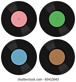four vinyl records on white background