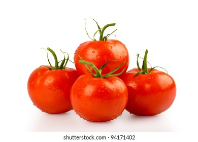 Four wet tomatoes isolated on white with clipping path included