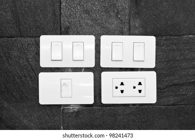 Four white wall mounted electrical plates