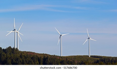 Four wind turbines on the coast of Washington State near Grayland.