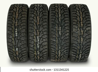 four winter tires isolated on white background