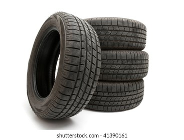Four winter tyres isolated on white background