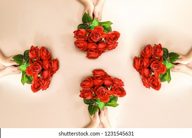 four woman hand holding a beautiful roses bouquet for holiday ( valentine's day ...)