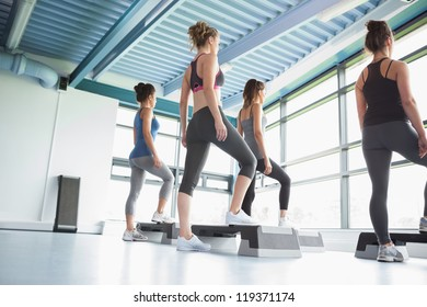 Four women at aerobics in gym