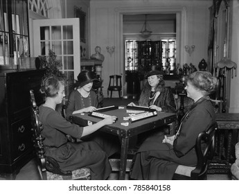 Four women playing Mah Jong, Dec. 30, 1922, in Washington, D.C. The first Mahjong sets sold in the U.S. were sold by Abercrombie & Fitch starting in 1920