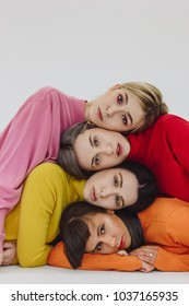 four women posing on white background
