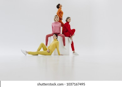 four women posing on white background