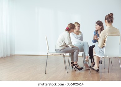 Four women talking in group about problems