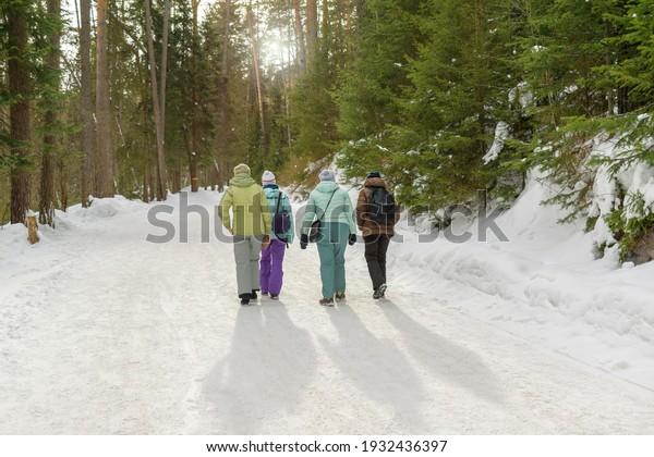 four-women-walk-along-snowy-600w-1932436