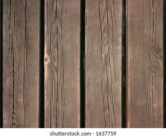 Four wooden boards lying in a row