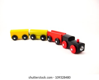 Four Wooden Toy Trains