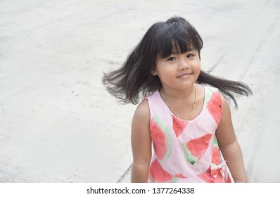 A four year old Asian girl, she is very cute and she poses a beautiful long hair flick.
