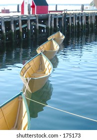 Four yellow boats