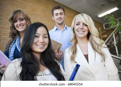 Four young, attractive students at school together