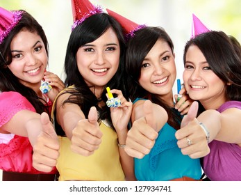 four young beautiful girls celebrate birthday isolated over white background