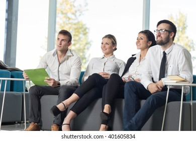 Four young business people sitting in a conference room on a meeting