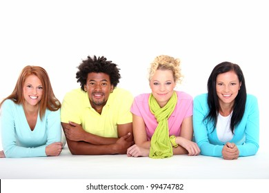 Four young friends lying down on the white background