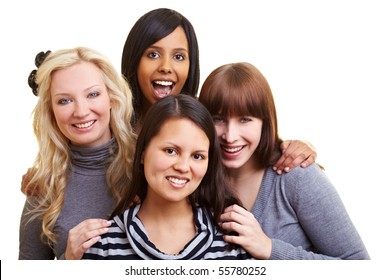 Four young happy smiling women grouped together