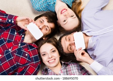 four young men lie together, applied to the face blank card