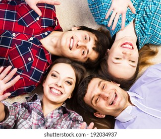 four young men lie together, four young men lie together, laughing and fooling around