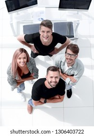 four young people looking at camera up