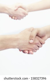 Four young people shaking hands