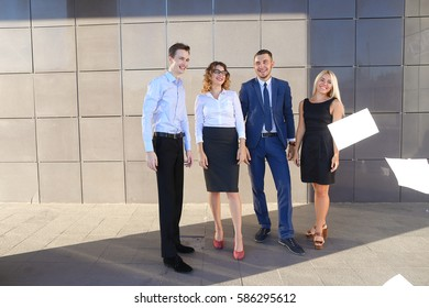 Four young people, two women and two men students, prospective entrepreneurs