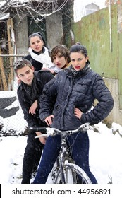 four young people in winter