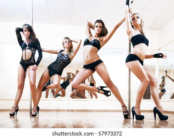 Four young sexy pole dance women. Bright white colors.