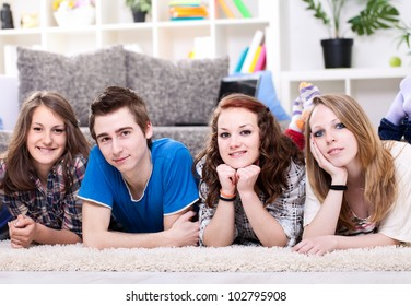 Four young students lined up for a portrait.