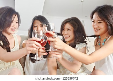Four young women toast and celebrating their meeting