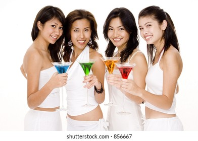 Four young women in white with colorful cocktails