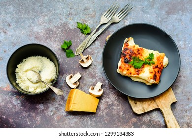 Four-cheese  Lasagne,on  a wooden background.Italian home made food