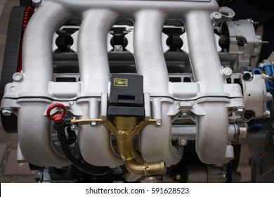 Four-cylinder automobile engine, a view of the intake manifold
