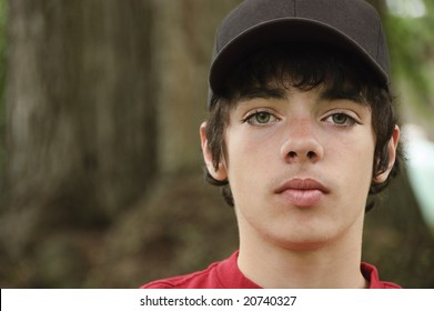 Fourteen year old teenage boy with black hat staring straight at the camera