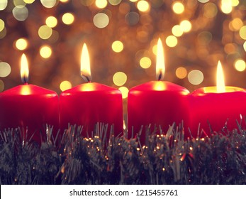 Fourth Advent candle burning, Seasonal background with red Advent candles and golden Christmas decoration
