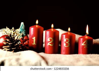Fourth Sunday (week) of Advent - four Advent candles (with four burning) and Christmas decoration